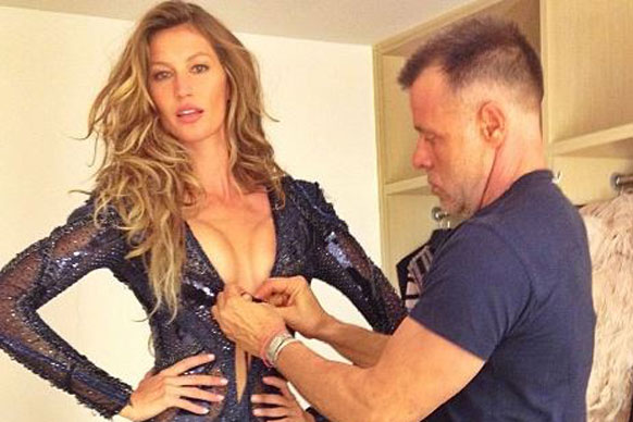 Gisele Bundchen pops out of her sheer bodysuit... and every man jumps up to help her out.