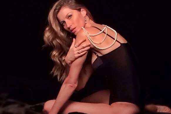 Here, Gisele goes classic in black lace and pearls.