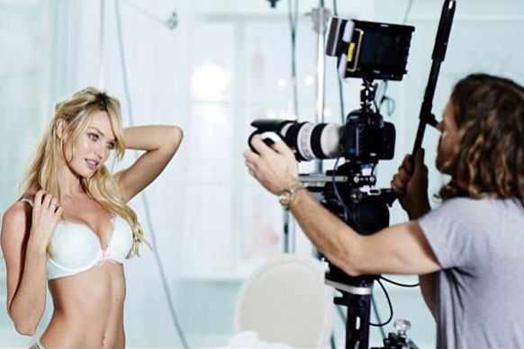 Tousled hair? Sexy smirk? Candice Swanepoel's got the signature saucy shoot moves down pat.