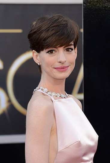 "Anne Hathaway was dubbed the ""headlights"" of the Oscars last year thanks to her pink Prada dress, and possibly a cold breeze"