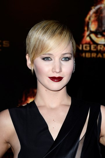 Nailing goth glam at the Catching Fire Paris premiere with a deep berry lip, porcelain skin tone and not a hair out of place in her sleek style.