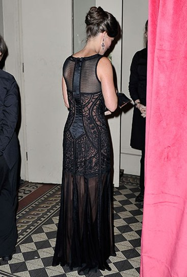 Pippa looks chic and sophisticated in this see-through black and embroidered dress. No signs of a fake butt here…
