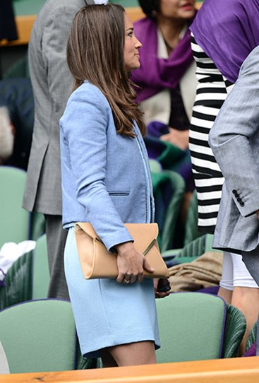 Attending Wimbledon in June last year, Pippa donned a powder blue jacket and skirt. Her bum? I think we all just need to admit that there's no trickery to it.